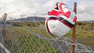 A punctured football on a fence at the proposed site for a ground for Ards FC