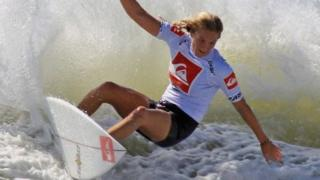 Four time world champion Stephanie Gilmore rides the waves during an exhibition round at the Quiksilver Pro New York tournament