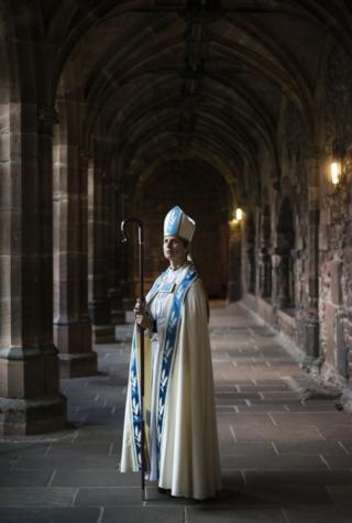 Portrait of a bishop in a church corridor