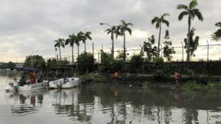 Lifeguards find a body on the Pasig River in Manila