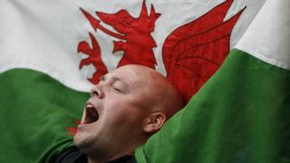 A Cardiff City fan singing and enjoying the day with his Welsh dragon flag during the 2008 FA Cup Final between Portsmouth and Cardiff City at Wembley Stadium in London, England, UK. (Photo by ben radford/Corbis via Getty Images)