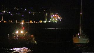 Douglas lifeboat Sir William Hillary with casualty vessel in Douglas harbour