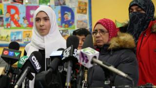 Khawlah Noman, 11, speaks to reporters with her mother at Pauline Johnson Junior Public School, after she told police that a man cut her hijab with scissors in Toronto, Ontario