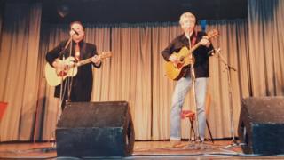 Elvis Costello performing alongside Nick Lowe (r) at the 1988 Shetland Folk Festival