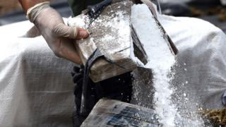 Authorities destroy a bale of cocaine