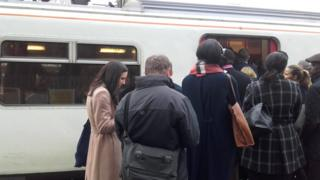 Passengers get onto an Greater Anglia service train