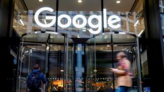 People walk past Google's UK headquarters in London on November 1, 2018