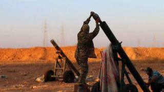 Photo posted by the Rased News Network, a Facebook page affiliated with Islamic State, shows Islamic State militants preparing to fire a mortar to shell towards Syrian government forces positions at Tal Arn in Aleppo province on 8 October 2015