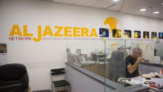 Employees of Al Jazeera satellite channel, work at their Jerusalem bureau, Israel, 14 June 2017
