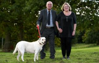 Alan and Jane Slater with Ruby the Labrador