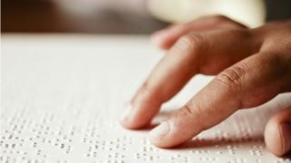 Hand reading Braille