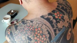 Image shows back tattoo typical of a Yakuza member