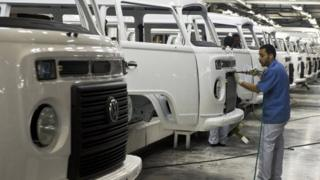 Worker at at VW factory in Brazil