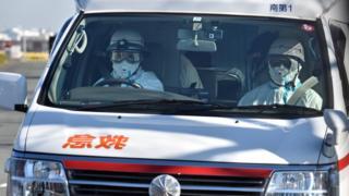 An ambulance departs the Japan Coast Guard base in Yokohama earlier this year