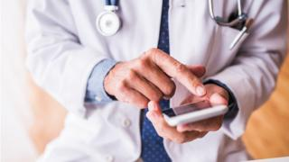 doctor holding smart phone