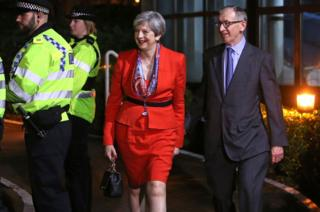 British Prime Minister Theresa May arrives with her husband Philip at the count centre in Maidenhead early in the morning of 9 June 2017.