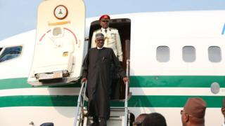 President Buhari wey come from im medical trip enter London