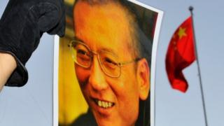 A protester holds an image of jailed dissident Liu Xiaobo outside the Chinese Embassy in Oslo, Norway on 9 December 2010.