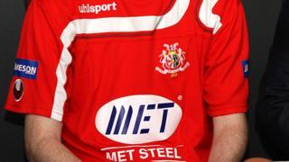 Met Steel logo on Portadown shirt