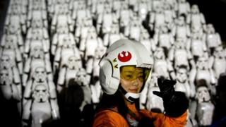 A Chinese Star Wars fan dressed in costume atop the Great Wall of China October 20, 2015.
