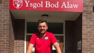 Gareth Hughes outside his school, Ysgol Bod Alaw
