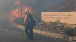 Firefighters battle to protect the Reagan Library from the Easy Fire in Simi Valley, California on October 30, 2019