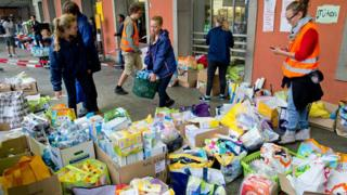 """Helpers sort through aid that has been donated for migrants at Munich""""s central railway station in Munich, Germany, 02 September 2015."""