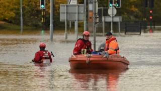 in_pictures Rescuers using a boat to get around Rotherham