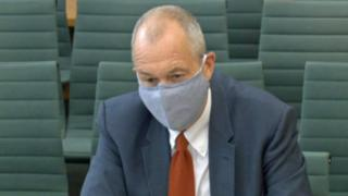 science Sir Patrick Vallance wearing a mask as he gives evidence to the science and technology committee