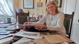 Julie with her memorabilia