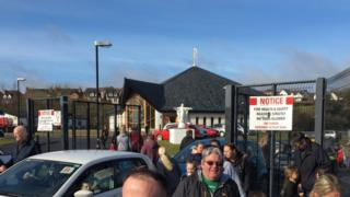 Children from Christ the Redeemer Primary School in Dunmurry were collected from a nearby church hall