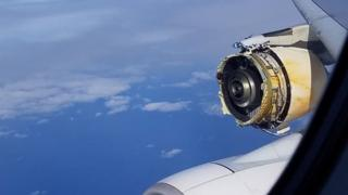 A photo shows the view form a plane in mid-air, with a severely damaged engine clearly visible, with parts missing and substantial metal damage