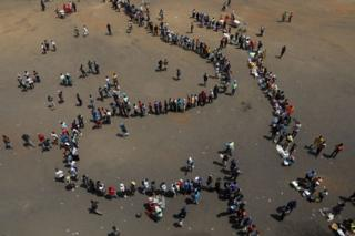 """Mourners arrive at Rufaro stadium, in Mbare township where the body of Zimbabwe""""s founder Robert Mugabe will lie in state, Harare, Zimbabwe, September 12, 2019"""
