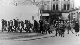 British paratroopers take away people in Londonderry on Bloody Sunday