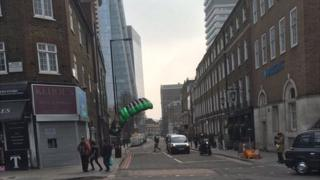 Base jumper landing on street