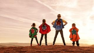 Siblings dressed as superheroes