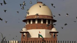 Pigeons fly past the dome of India's Supreme Court building in Delhi. Photo: February 2016