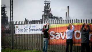 A union banner outside the Port Talbot plant on Monday