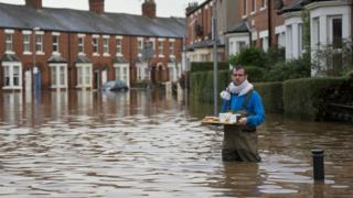 Man with drinks in flood water