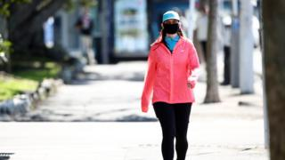 A woman wearing a mask in Auckland