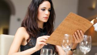 Women looking at wine list