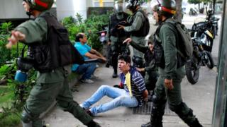 A demonstrator is detained at a protest against President Nicolas Maduro in Caracas, Venezuela, July 27, 2017