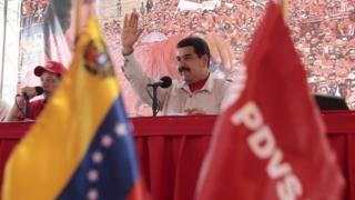 Venezuela's President Nicolas Maduro waves to supporters on 1 August, 2015