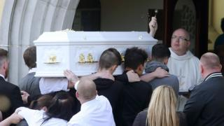 Caitlin White's coffin entering the Church of the Assumption in Newry