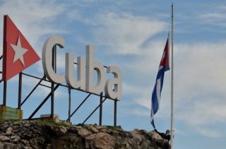 """The Cuban national flag is raised at half-mast in tribute to the victims of a plane that crashed shortly after taking off from Jose Marti airport and killed 107 people, in Havana, on May 19, 2018. Cuba begins two days of national mourning Saturday for victims of the crash of a state airways plane that killed all but three of its 110 passengers and crew. President Miguel Diaz-Canel said an investigation was under way into Friday""""s crash of the nearly 40-year-old Boeing 737, leased to the national carrier Cubana de Aviacion by a Mexican company. / AFP PHOTO / Yamil LAGEYAMIL LAGE/AFP/Getty Images"""