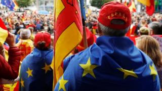 Spanish protesters draped with EU flags in Brussels. File photo