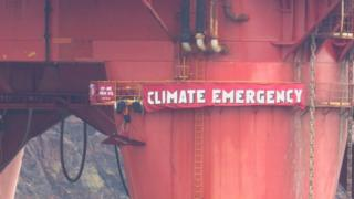 Campaigners' banner on rig