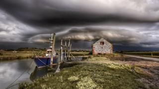 Weather 'super cell' builds over Thornham Staithe