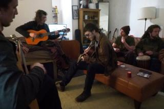 A group of people playing guitars