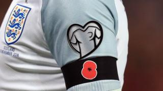 Wayne Rooney wearing a poppy at the World Cup qualifier on Armistice Day